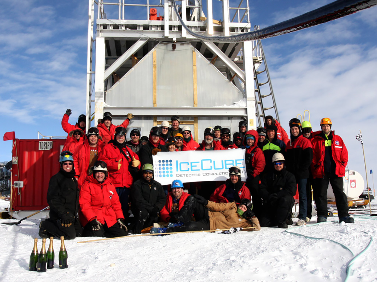 Group photo in front of drill tower