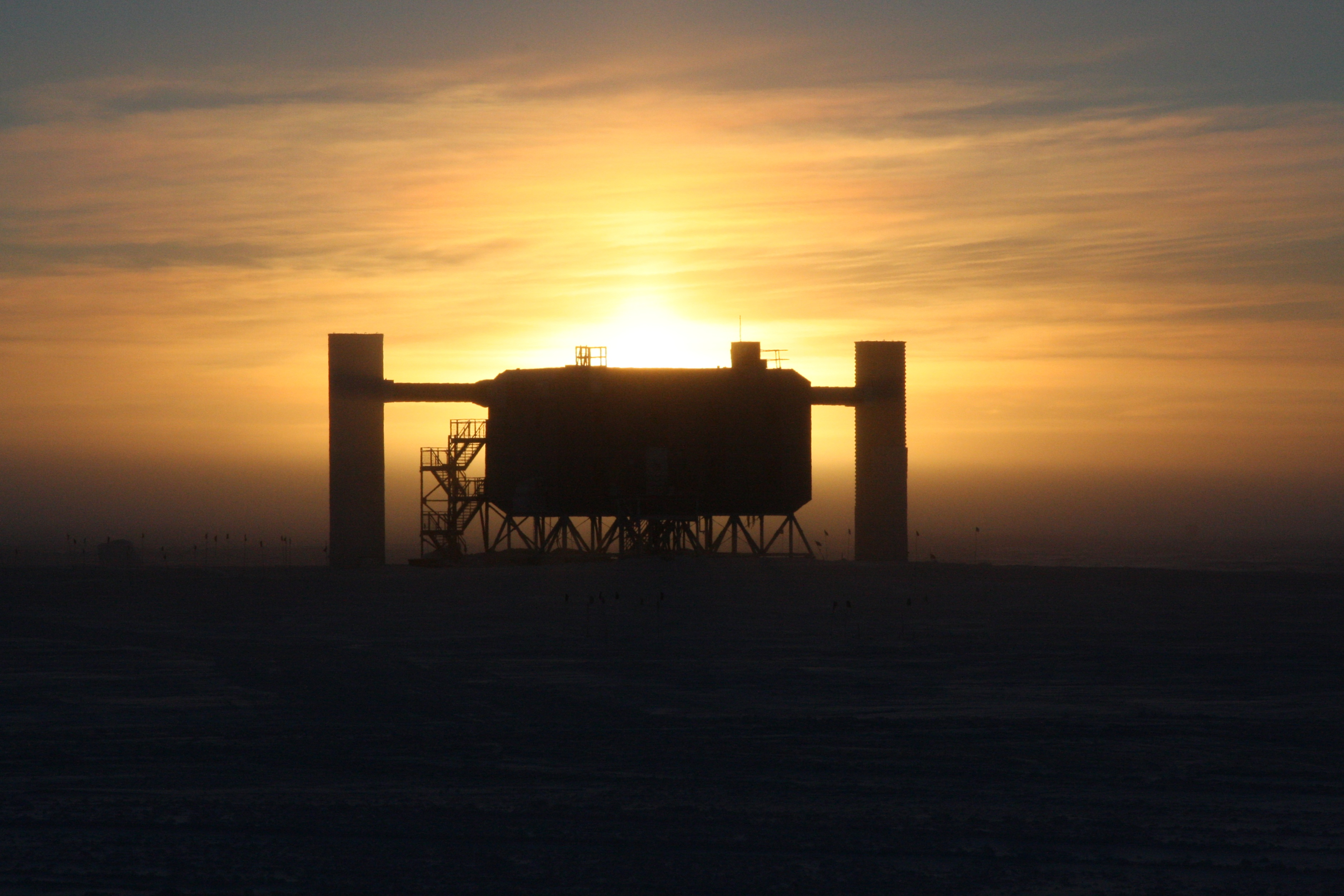 Sun setting behing the IceCube Lab