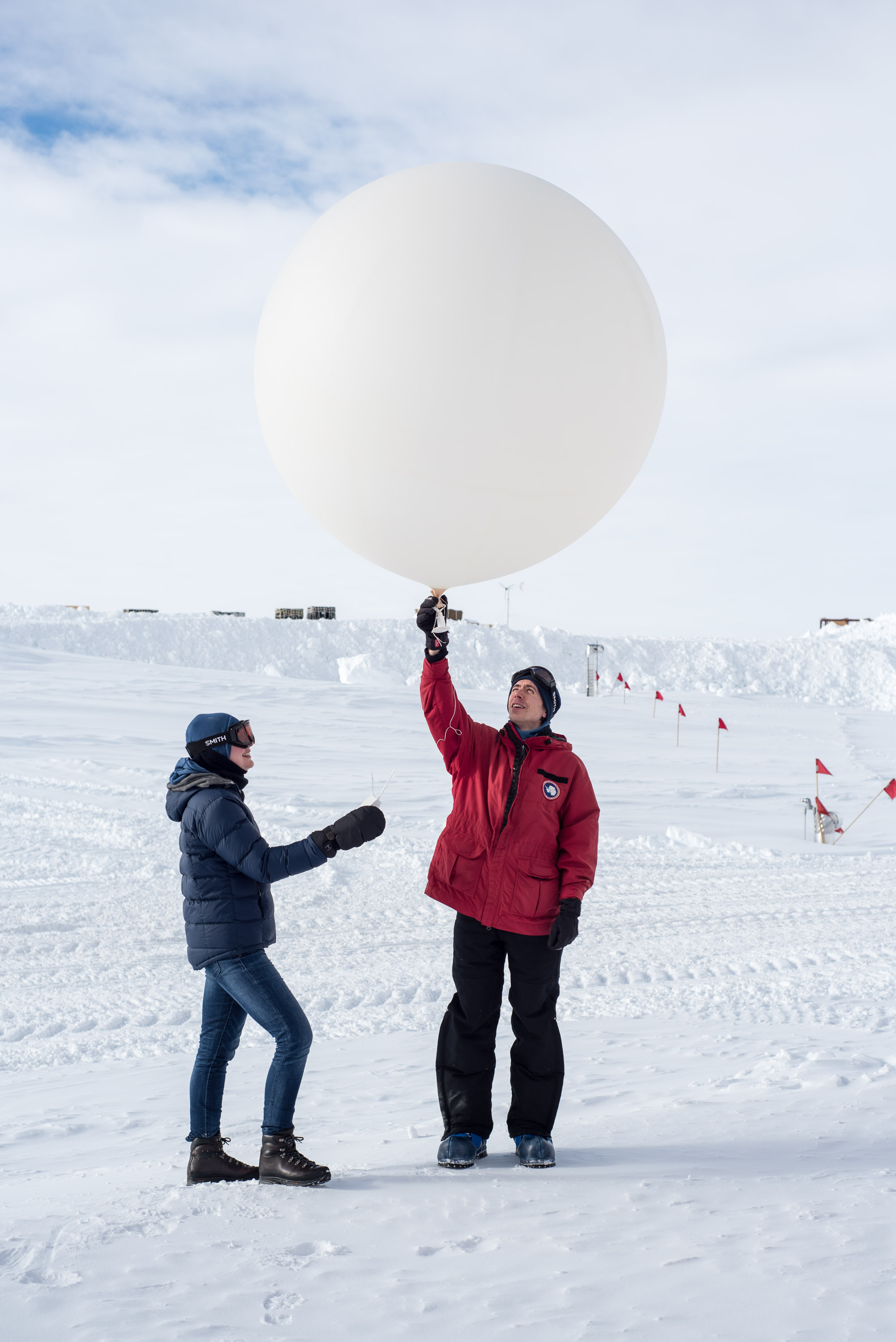IceCube winterovers playing with a weather balloon